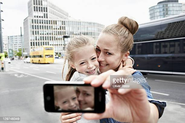a mother and her daughter taking photos