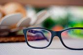 a pair of eyeglasses on a white plane