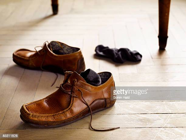 a pair of shoes and socks on the floor