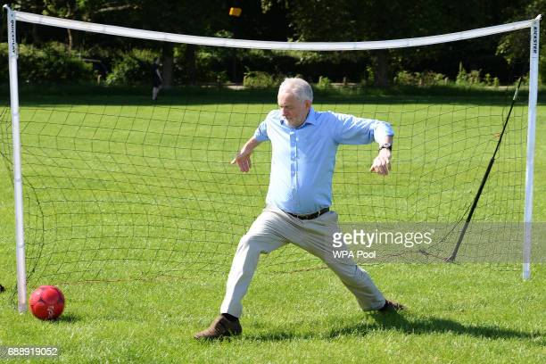 a penalty kick from a child gets past Labour Party leader Jeremy Corbyn during a visit to Hackney Marshes Football Pitches to highlight Labour's...