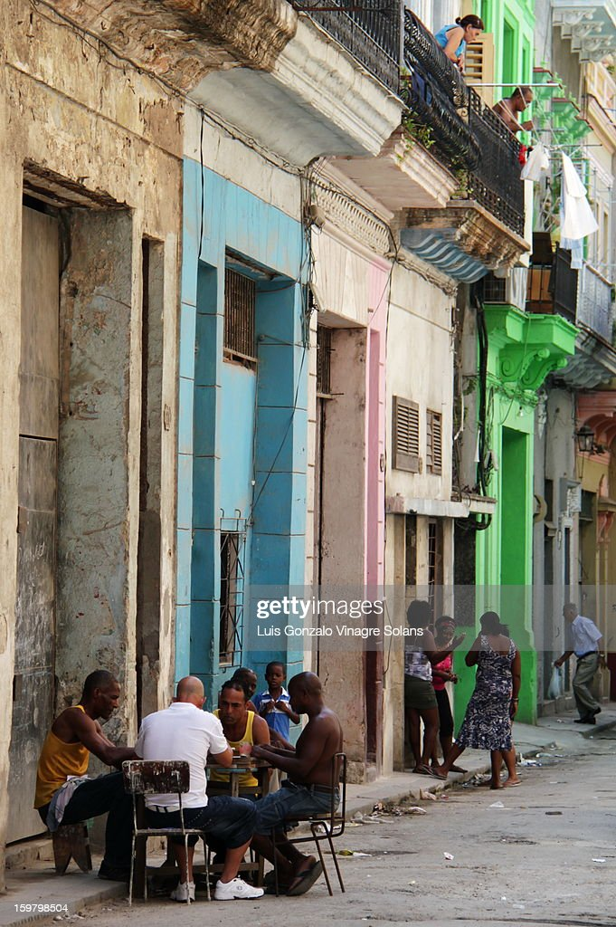 CONTENT] a picture of everyday life in old havana, where typically men sit on the street around a table playing cards, women gather around for chit chat and the latest gossip and, a passer by crossing the street, and men and women standing on their balconies with hung clothers watching life go by, all set in the advanced state of dilapidation of old havana and the island in general