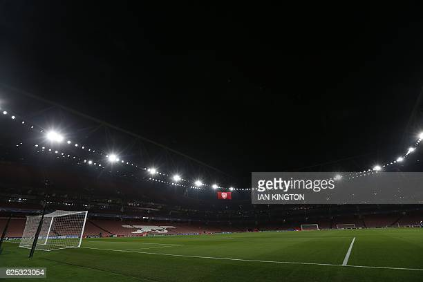 a picture shows a view of the pitch and empty stands at the Emirates Stadium in London on November 23 2016 ahead of the UEFA Champions League group A...