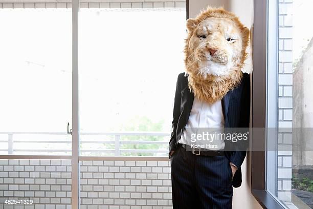 a portrait of business man with lion head