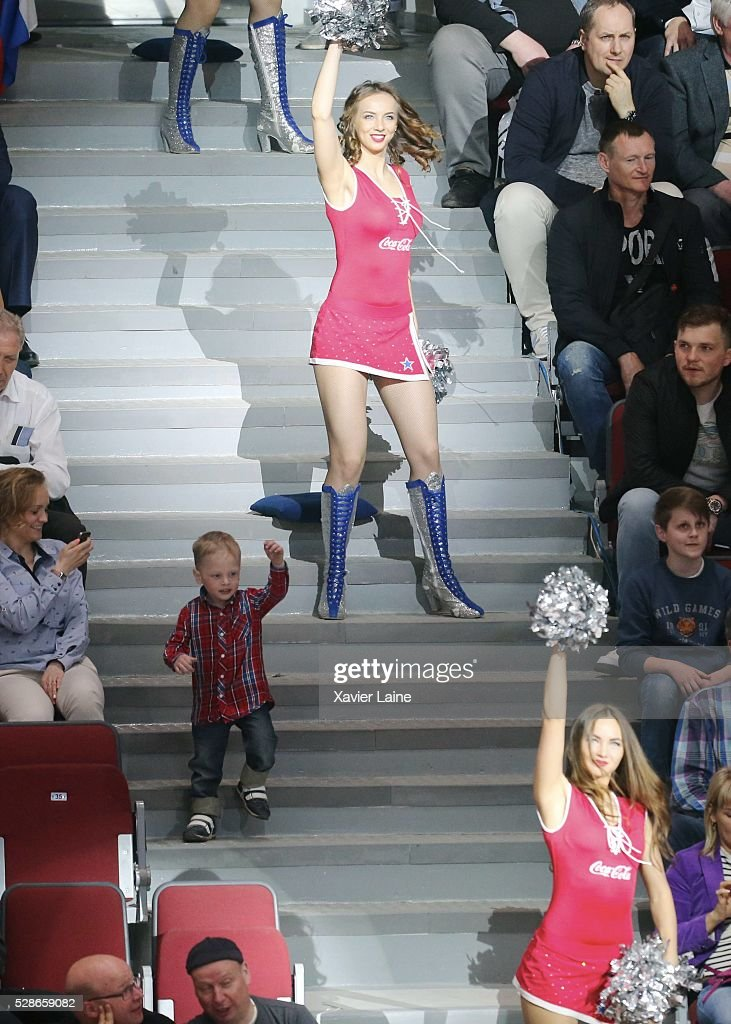 a Russian kids dance with a cheerleader during the 2016 IIHF World Championship between USA and Canada at Yubileyny Sports Palace ,on May 6, 2016 in Saint Petersburg, Russia.