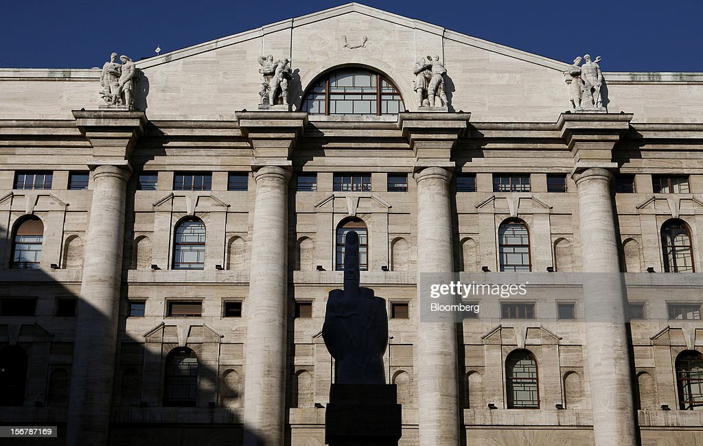 E., a sculpture by Italian artist Maurizio Cattelan, stands in front of the Borsa Italiana, Italy's stock exchange and part of the London Stock Exchange Group Plc, in Milan, Italy, on Tuesday, Nov. 20, 2012. Telecom Italia SpA said it is still reviewing the possible spinoff of its fixed-line network and the company's board will discuss the outcome of its analysis on Dec. 6. Photographer: Alessia Pierdomenico/Bloomberg via Getty Images