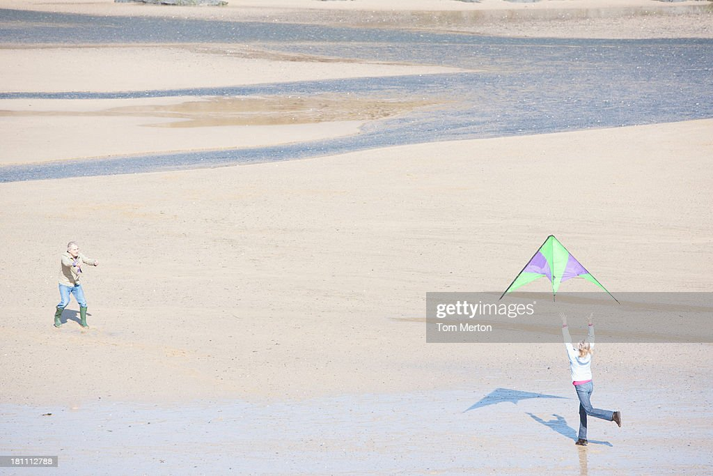 a senior woman with a kite at the beach : Stock Photo