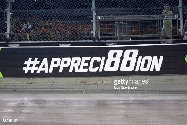 a sign at Bristol Motor Speedway in respect to Dale Earnhardt Jr retiring during the running of the 57th annual Bass Pro Shops NRA Night Race 500 on...
