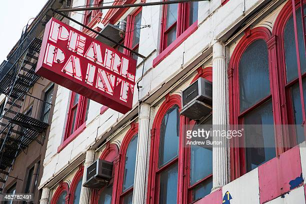 a sign hangs outside Pearl Paint a famed art supply and paint store on Canal Street on April 10 2014 in New York City The Building Pearl Paint...