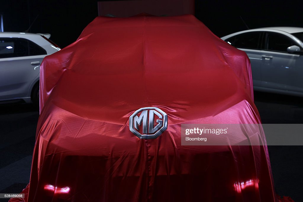 GS, a sports utility vehicle (SUV), manufactured by MG Motor UK Ltd. sits covered before its unveiling at the London Motor Show in London, U.K., on Thursday, May 5, 2016. MG Motor UK Ltd. manufactures convertible sport coupes with various options, features, and accessories to choose from. Photographer: Simon Dawson/Bloomberg via Getty Images