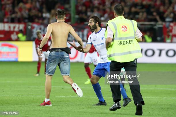 a streaker of kaiserslautern and Hamit Altintop of Darmstadt during the Second Bundesliga match between 1 FC Kaiserslautern and SV Darmstadt 98 at...