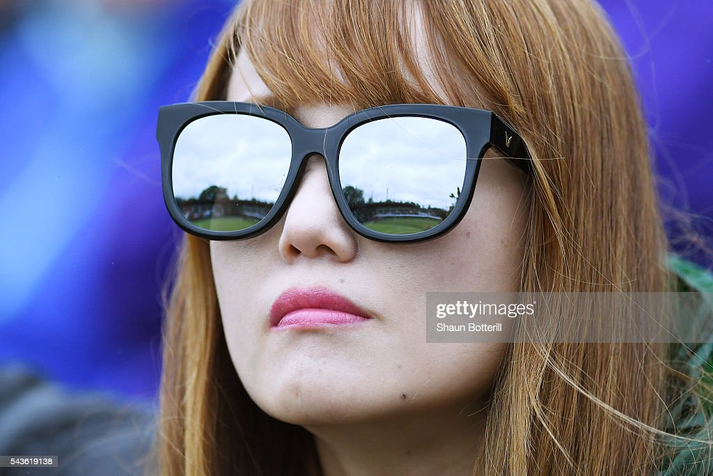 a supporter looks on from court two on day three of the Wimbledon Lawn Tennis Championships at the All England Lawn Tennis and Croquet Club on June 29, 2016 in London, England.