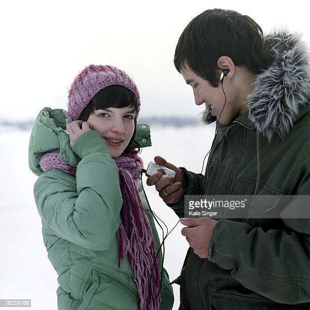 a teenage couple with their cellular phones
