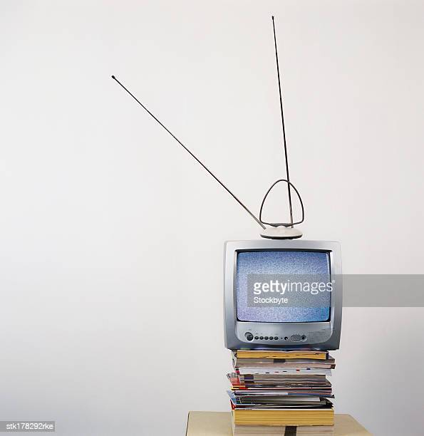 a television elevated with books