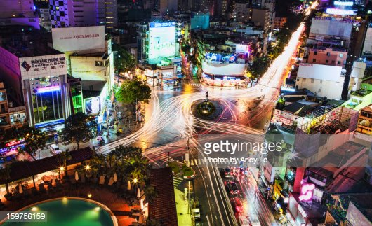 a traffic-circle in Saigon after night rain : Stock Photo
