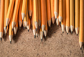 a variety of graphite pencils on wooden background,closeup
