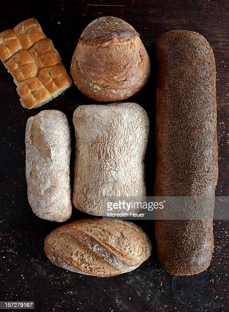 a variety of loaves of bread from above