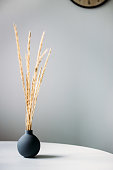 a vase on a white table. The concept of the minimalist Scandinavian style