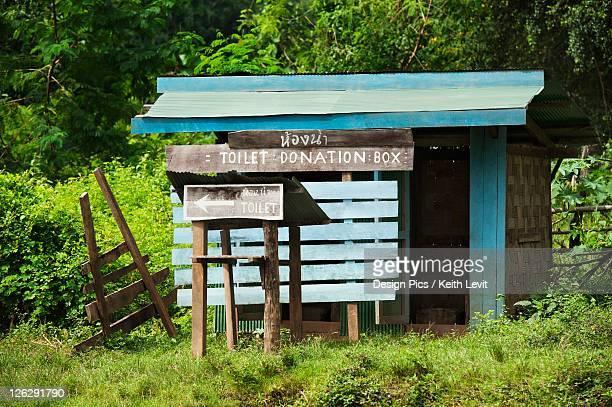 a washroom in a long necked village called huay pu keng near mae hong son