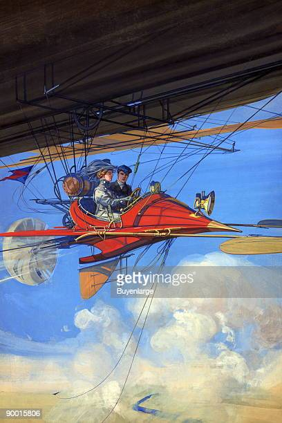 a woman at the wheel of a futuristic aircraft A man sits beside her
