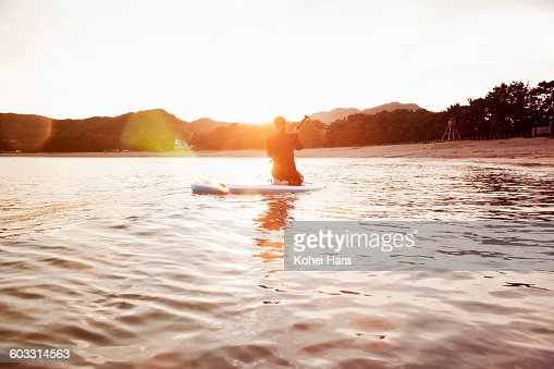 a woman enjoys water sports in the sea