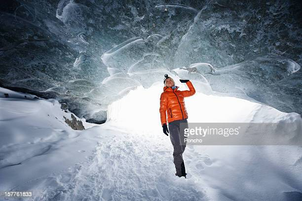 a woman exploring an ice cave