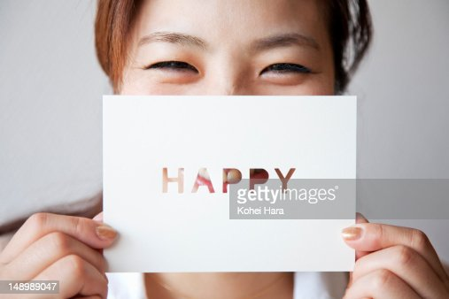 a woman holding a card