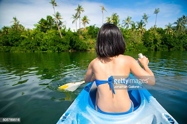 POV of a woman riding in a kayak