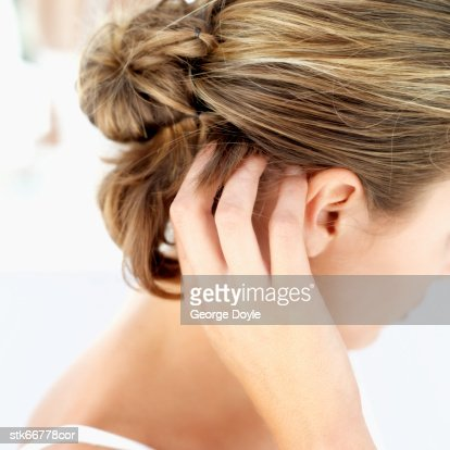 a woman scratching her scalp