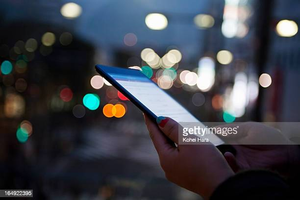 a woman using a digital tablet