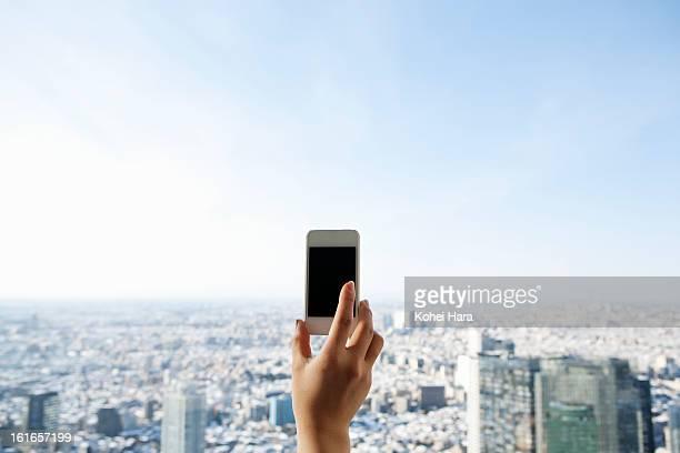 a woman using a smart phone in a skyscraper