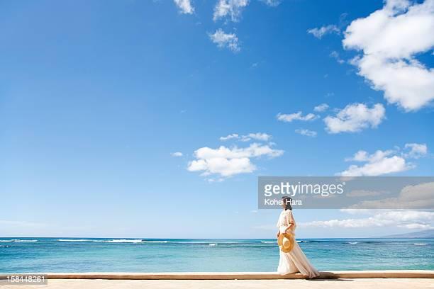 a woman walking at seaside