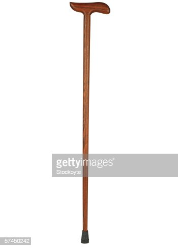 a wooden walking cane