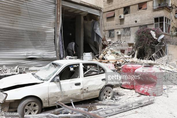 a wreckage of a car outside the collapsed Arbin hospital after Assad Regime's airstrike hit residential areas at the Arbin district of Eastern Goutha...