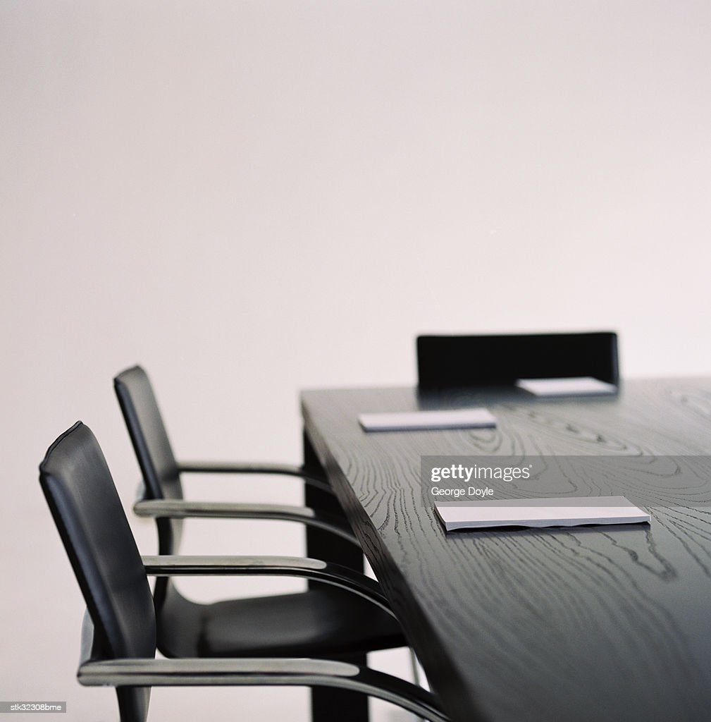 a writing pad placed at every seat on a table : Stock Photo