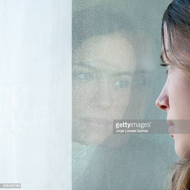 a young and beauty girl reflected in the mirror
