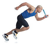 a young black male athlete is bald and wearing a blue tank top while carrying a baton as he begins running
