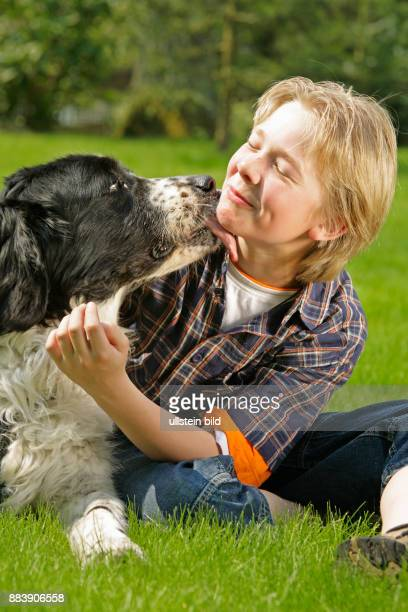 a young boy and his dog people children kids boys animals pets dogs fondle fondling licking pet friendship friends portrait