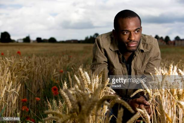 a young farmer tends his crops