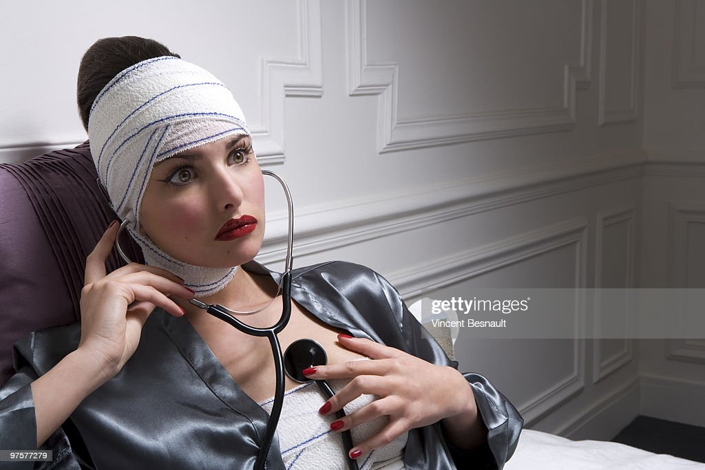 a young woman listening to her heart  : Stock Photo