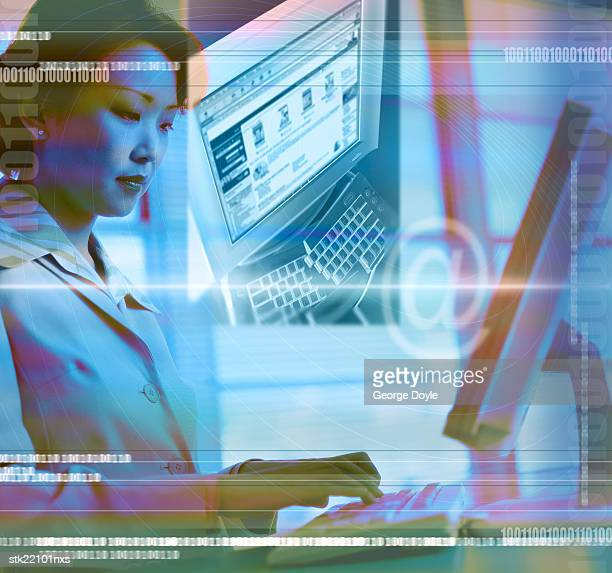 a young woman sitting in front of a computer with binary code superimposed (toned)