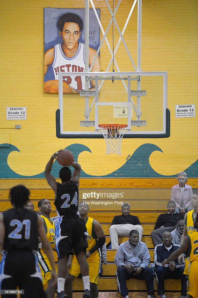 aA painting of former Spingarn and NBA great Dave Bing hangs in his former high school gym during a game with Eastern. Spingarn's basketball program will end as the school closes at the end of the school year in Washington DC, February 12, 2012 .