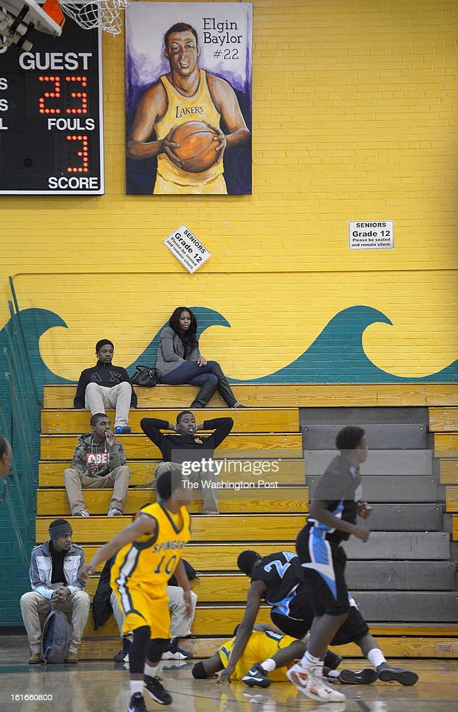 aA painting of former Spingarn and NBA great Elgin Baylor hangs in his former high school gym. Spingarn's basketball program will end as the school closes at the end of the school year in Washington DC, February 12, 2012 .
