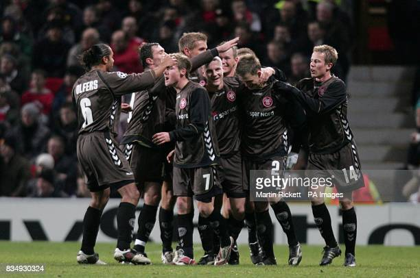 AaB Aalborg's Michael Jakobsen is congratulated by his teammates after scoring his sides first goal of the game