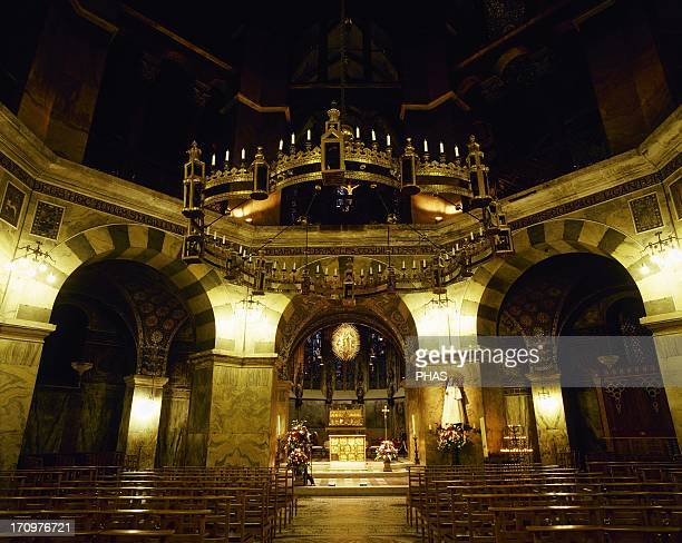 Aachen Cathedral Palatine Chapel Interior with the bronze chandelier provided by emperor Barbarossa 1168 Germany