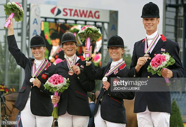 British riders Zara Phillips Daisy Dick Mary King and William Fox Pitt celebrate on the podium after placing second in the Eventing team competition...