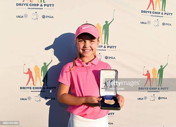 Aadyn Long poses with her medal after winning the Chipping competition in the Girls 79 yr old division during the Drive Chip and Putt regional...
