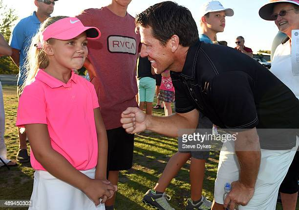 R Aadyn Long smiles with her father Rob Long after winning the Overall competition in the Girls 79 yr old division of the the Drive Chip and Putt...