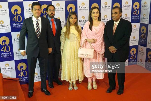 Aakash Ambani Anant Ambani Isha Ambani Nita Ambani and RIL Chairman Mukesh Ambani pose for a group photo before the 40th AGM of Reliance Industries...