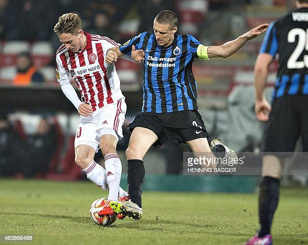 Aalborg's Andreas Bruhn vies for the ball with Club Brügge's Timmy Simons during Aalborg BK v Club Brugge KV during UEFA Europa League Round of 32 on...