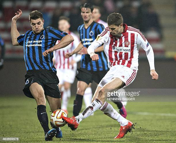 Aalborg's Nicklas Helenius and Club Brugge's Thomas Meunier vie for the ball during Aalborg BK v Club Brugge KV during UEFA Europa League Round of 32...